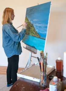 Shannon at work painting a canvas